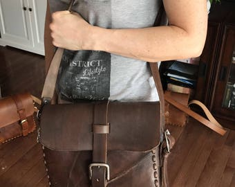 Leather scar messenger bag