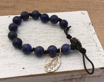 Single Wrap Round Leather Knotted Bracelet with 10mm Soldalite beads and Guide medallion.