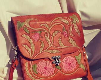 Beautifully tooled  pink floral hibiscus and leaf design leather purse.
