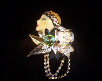 Bonetto Woman's Face Fancy Brooch with Watch