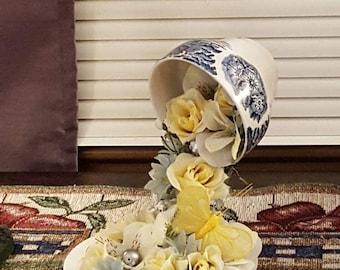 Floating floral teacup