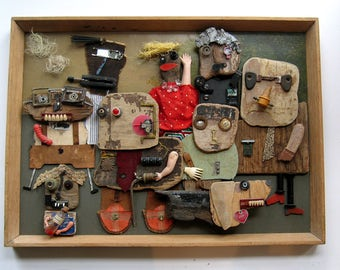 Mixed media collage assemblage box art titled 'Family' by Flott & Jett