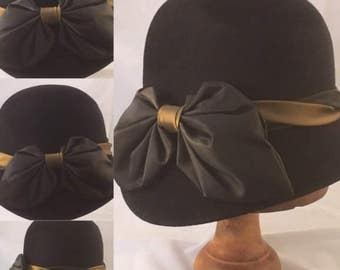 A stylish Mulberry black velour/fur felt cloche with a chocolate brown and bronze taffeta trim