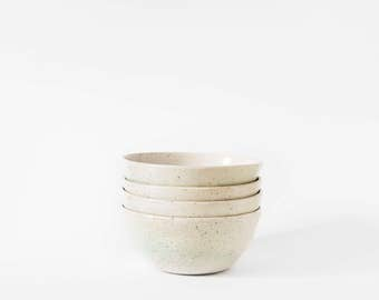 Set of 4 white stoneware bowls with grey speckles and green mist, wheel-thrown ceramic handmade