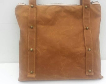 Tan studded waxed canvas handbag