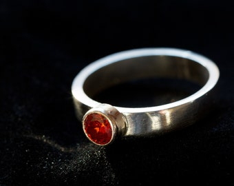Sterling silver stacking ring with red crystal