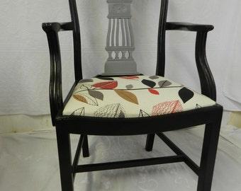 Elegant re-upholstered antique carver chair