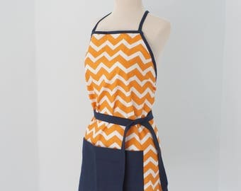 White and orange chevron apron with navy blue accents