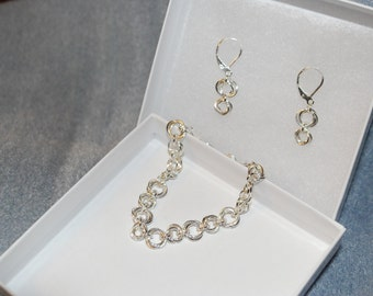 Sterling Silver chainmaille bracelet and matching earrings.