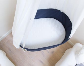 Stylish hanging swinging baby cradle / crib. Navy blue. Natural & organic materials. Perfect first bed for your baby's natural deep sleep!
