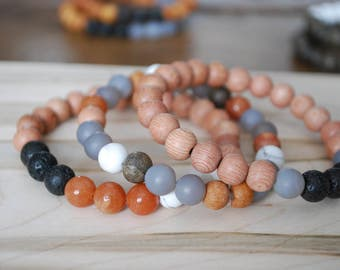 Triple stacked essential oil diffuser bracelet yoga bracelet mala beads rosewood frosted howlite lava beads red aventurine grey agate