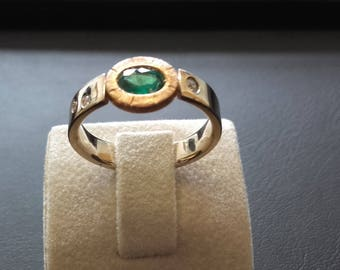 ring 18 ct gold natural Emerald and diamond color with bi.