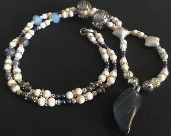 Blue Tigers Eye with navy blue Swarovski pearls and silver and white accents