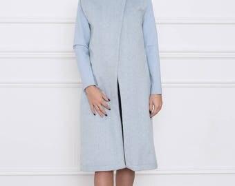 The long light blue waistcoast
