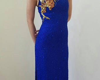Prom dress; blue heavy beaded dress with open back detail