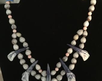 Blue water buffalo teeth and seed bead necklace
