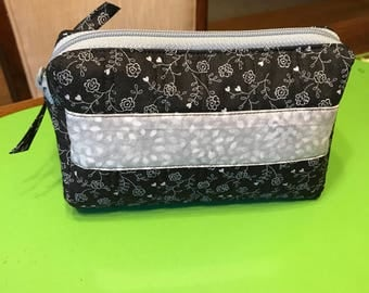 Small Quilted makeup bag, fits perfectly in your purse.