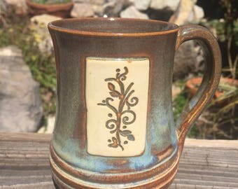 Cup - rust and blue with sprig design