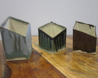Three (3) small square base vases