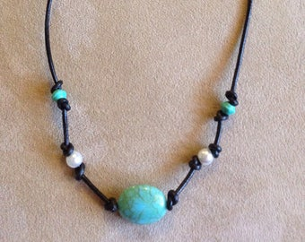 Turquoise and Pearl colored beads on Black Leather cord necklace