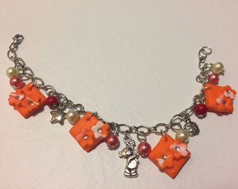 Polymer clay bracelet with charms