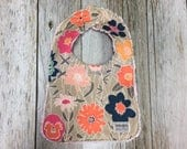 Baby Girl's Bib in Peach, Navy and Mint Floral Fabr...