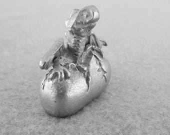 Tiny Pewter Dragon hatching from an Egg
