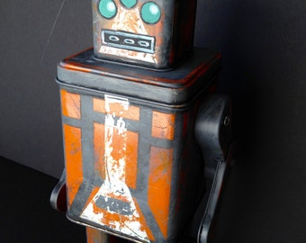 robot orange and grey spacebot found object sculpture