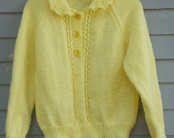 Girl's  Yellow sweater with lacy panels and ruffled collar, size 8/10.
