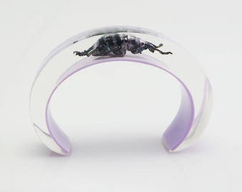 Lilac lucite cuff bracelet with real beetle