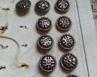 15 Antique Austrian Metal Buttons. Partial Card.