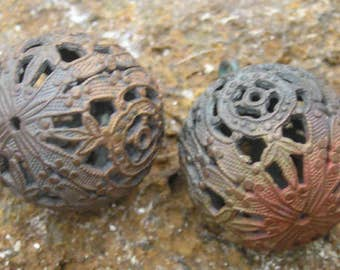 Two vintage raw French brass filigree balls for authentic Steampunk splendour..