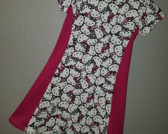 Handmade Girls Hello Kitty fabric knit dress! Available in sizes 2T to little girls size 6! Short or long sleeves available.