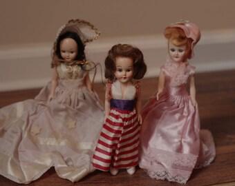 3 vintage mid century hard plastic dolls