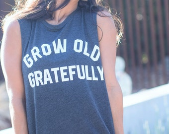 Grow Old Gratefully. Crew Neck Boyfriend Muscle Tee. Made in the USA. 11 Colors to Choose From. Quote Tank Top. Womens Tank Top. Workout Top