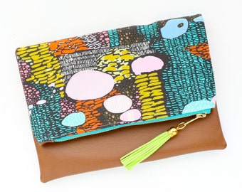 Boho Confetti Tassel Clutch in an Abstract Multi Color Print and Tan Vegan Leather and Gold zipper close