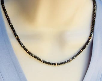 Black spinel gemstone strand necklace with gold spacers