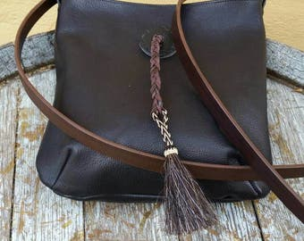 Leather bag with horsehair tassel