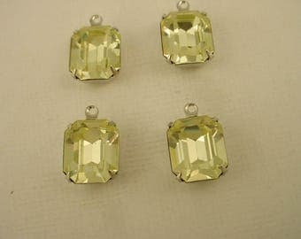 4 vintage glass Swarovski Jonquil yellow  Octagon 12x10 stones  closed  back silver setting 1 ring charms