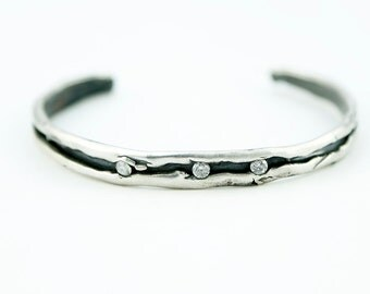 Rolled edge Organic Sterling Silver Cuff with accent czs