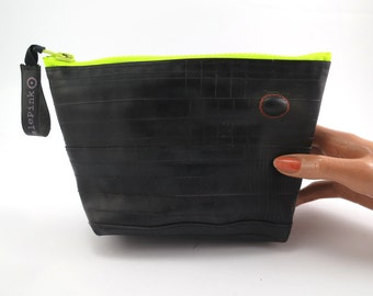 Recycled bicycle inner tube cosmetic pouch for men and woman, container, bag, with neon green zipper.