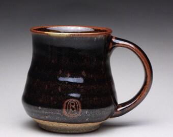 handmade pottery mug, ceramic tea cup, coffee mug with black tenmoku and green celadon glazes