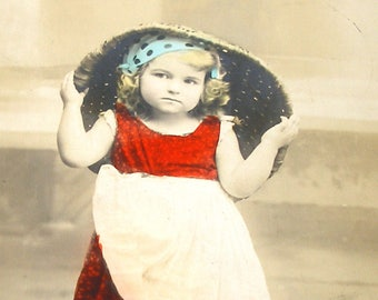 1900s French postcard, Girl with basket & spilled flowers,  RPPC real photo.