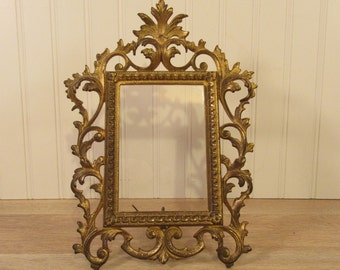 Ornate metal art nouveau frame with stand and glass insert- solid, functional, beautiful and in fine condition