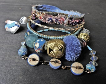 "Rustic bangle stack in shades of blue. Beaded stitched textile bohemian bracelet set- ""Sea So Deep"""