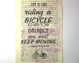 Life is like riding  a bicycle print on a book page