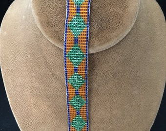Beaded bracelet, green , orange, blue
