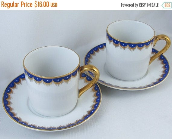 SPRING CLEANING SALE Pair of vintage Fitz and Floyd white blue hand painted demitasse cup and saucer / porcelain / china / bone china / tea