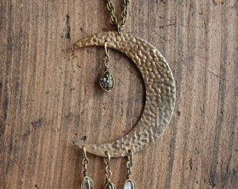 Luna Necklace. Antique Brass Crescent Moon Necklace with Crystal Quartz and Pyrite Charms.