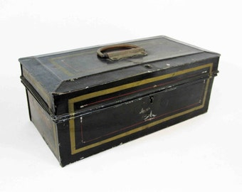 """Vintage Metal Lock Box In Black with Pinstripes. Marked """"E.E. Canning"""". Circa 1910's - 1920's."""